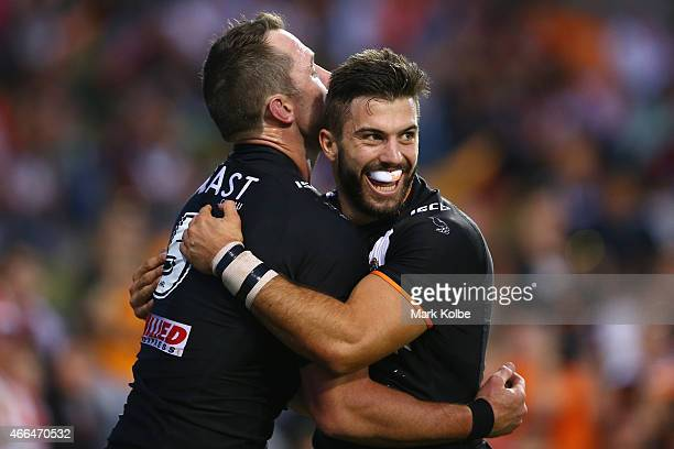 Pat Richards celebrates with his team mate James Tedesco of the Tigers after scoring a try during the round two NRL match between the Wests Tigers...