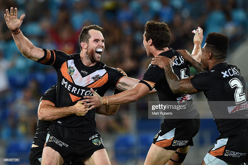 Pat Richards of the Tigers celebrates kicking a field goal with team mates during the round one NRL match between the Gold Coast Titans and the Wests Tigers at Cbus Super Stadium on March 7, 2015 on the Gold Coast, Australia.