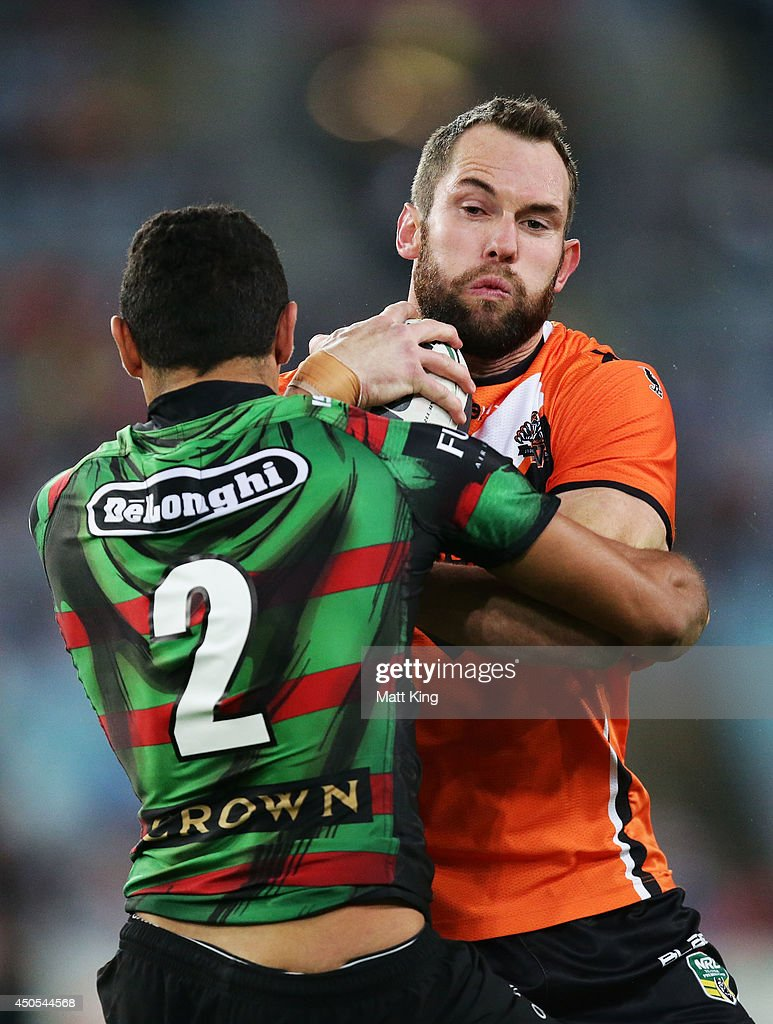 Pat Richards of the Tigers takes on the defence during the round 14 NRL match between the South Sydney Rabbitohs and the Wests Tigers at ANZ Stadium on June 13, 2014 in Sydney, Australia.