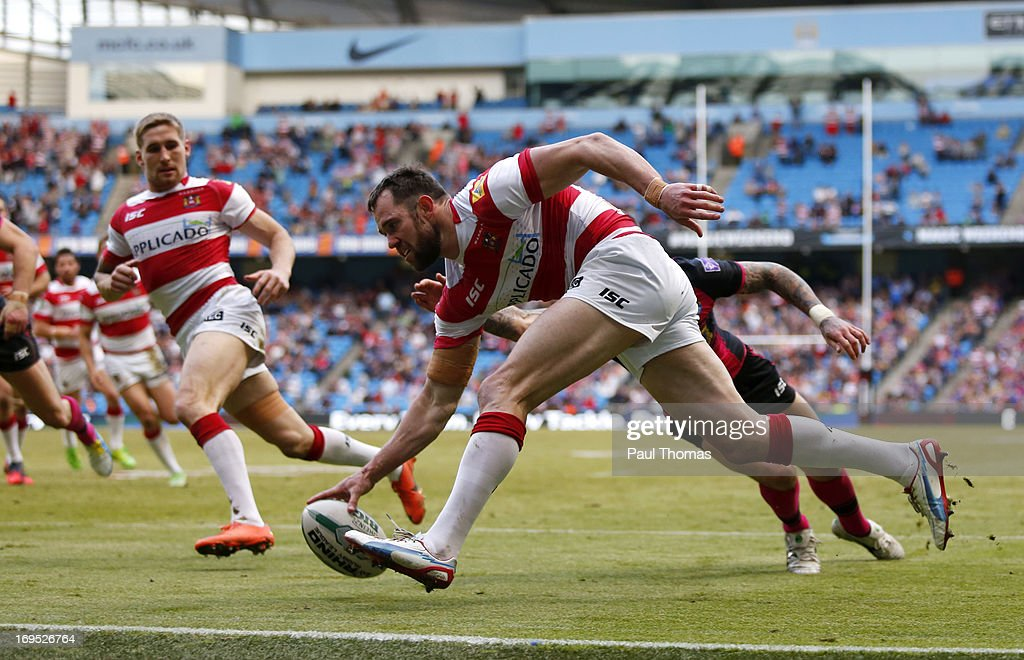<a gi-track='captionPersonalityLinkClicked' href=/galleries/search?phrase=Pat+Richards&family=editorial&specificpeople=233418 ng-click='$event.stopPropagation()'>Pat Richards</a> of Wigan scores a try during the Super League Magic Weekend match between Leeds Rhinos and Wigan Warriors at the Etihad Stadium on May 26, 2013 in Manchester, England.