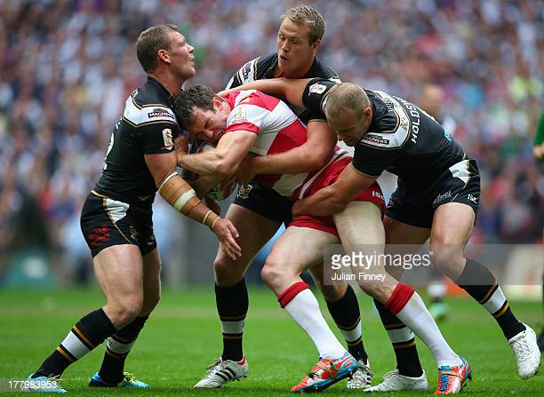 Pat Richards of Wigan Warriors is tackled by Daniel Holdsworth of Hull FC during the Tetley's Challenge Cup Final between Wigan Warriors and Hull FC...
