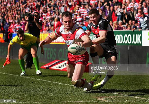 Pat Richards of Wigan Warriors scores his try against St Helens during the Super League match between Wigan Warriors and St Helens at DW Stadium on...