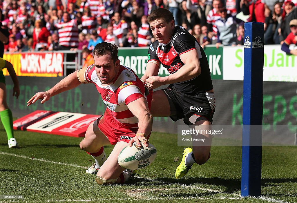 <a gi-track='captionPersonalityLinkClicked' href=/galleries/search?phrase=Pat+Richards&family=editorial&specificpeople=233418 ng-click='$event.stopPropagation()'>Pat Richards</a> of Wigan Warriors scores his try against St Helens during the Super League match between Wigan Warriors and St Helens at DW Stadium on March 29, 2013 in Wigan, England.