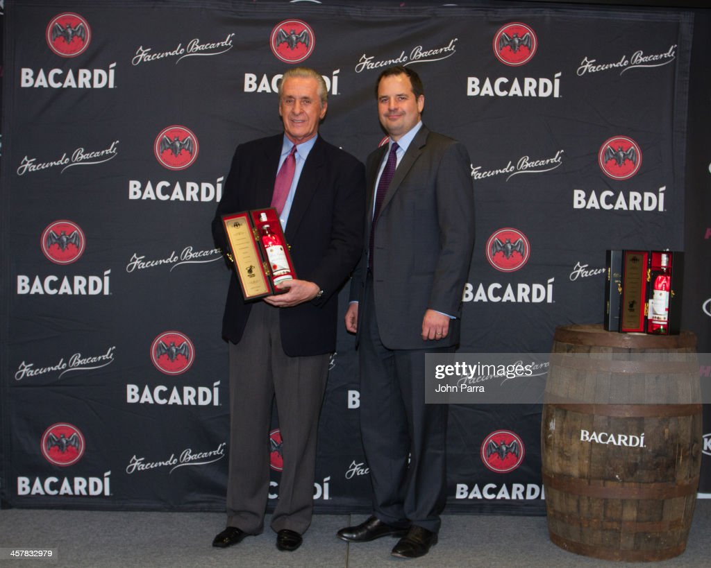 Pat Riley President of the Miami Heat and Toby Whitmoyer Vice President and brand managing director for the rum category at Bacardi USA toast to a winning season with a limited-edition bottle of BACARDI Superior rum at American Airlines Arena on December 18, 2013 in Miami, Florida.