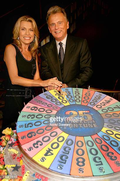 Pat Sajak and model Vanna White cut cake at the the 25th anniversary celebration of the television game show 'Wheel Of Fortune' at Radio City Music...