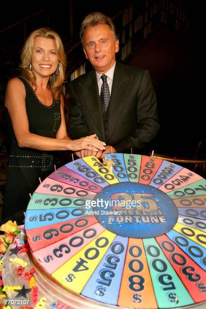 Pat Sajak and model Vanna White cut the cake at the the 25th anniversary celebration of the television game show 'Wheel Of Fortune' at Radio City...