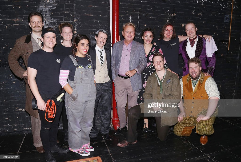 Pat Sajak poses with the cast backstage at the hit play 'The Play That Goes Wrong' on Broadway at The Lyceum Theatre on August 16, 2017 in New York City.