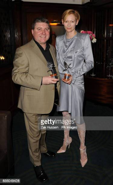 Pat Shortt and Tilda Swinton pose with their awards during the Evening Standard British Film Awards 2009 held at The Ivy restaurant London