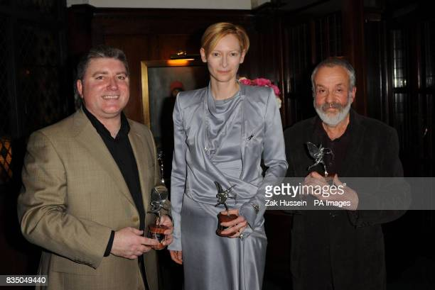 Pat Shortt Tilda Swinton and Mike Leigh pose with their awards during the Evening Standard British Film Awards 2009 held at The Ivy restaurant London