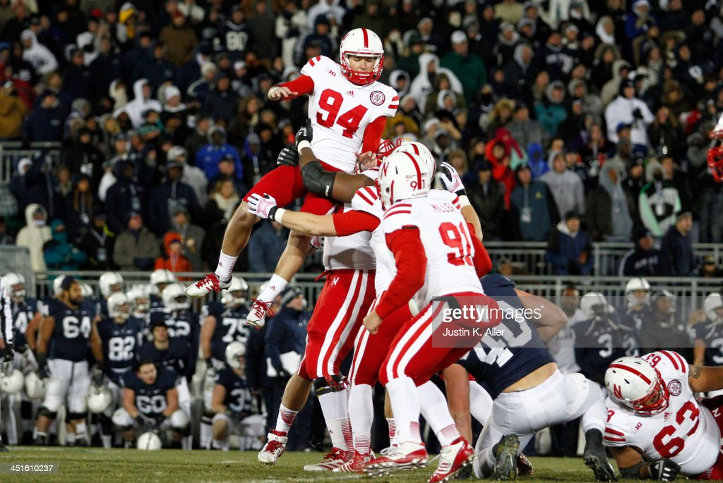 Pat Smith #94 of the Nebraska Cornhuskers celebrates after kicking the game winning overtime field goal against the Penn State Nittany Lions during the game on November 23, 2013 at Beaver Stadium in State College, Pennsylvania.