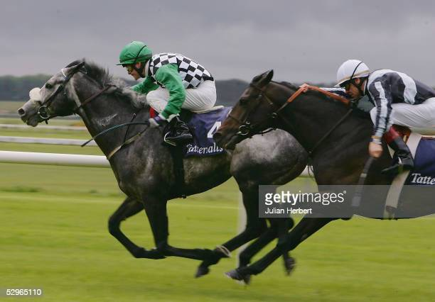 Pat Smullen and Grey Swallow lead the Thierry Gillet ridden Bago home to land The Tattersalls Gold Cup Race run at The Curragh Racecourse on May 22...