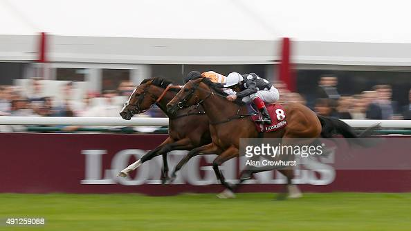 Pat Smullen riding Covert Love win The Prix DeL'Opera Longines from Jazzi Top and Frankie Dettori at Longchamp racecourse on October 04 2015 in Paris...