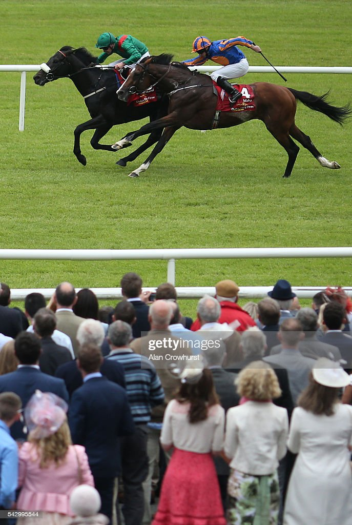 Pat Smullen riding Harzand win The Dubai Duty Free Irish Derby from Idaho and Ryan Moore at Curragh racecourse on June 25 2016 in Kildare Ireland
