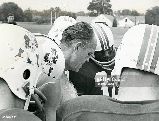 'Pat the Patriot' logo adorned the helmets of the players as they listened to coach Mike Holovak The orginal logo was the creation of Phil Bissell a...