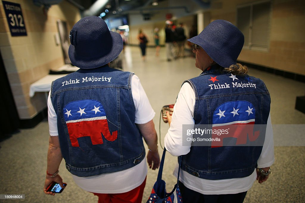 Pat Tippett of Baxley GA and Linda Dennison of Blackshear GA wear GOP logo cutoff jean jackets with matching blue hats during the third day of the...