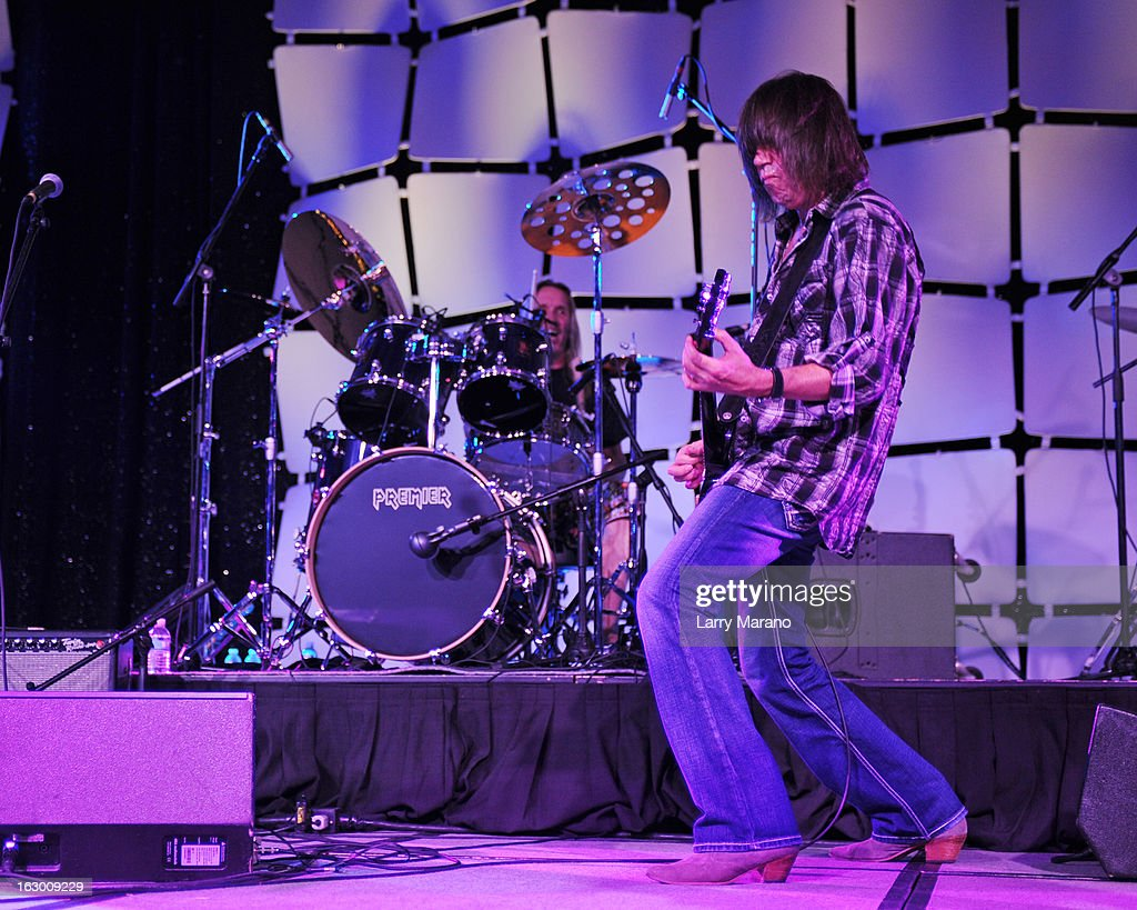 Pat Travers and Nicko McBrain perform at The Classic Rock And Roll Party to benefit HomeSafe at Seminole Hard Rock Hotel on March 2, 2013 in Hollywood, Florida.