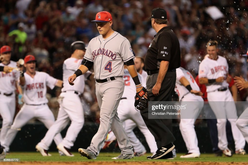 Pat Valaika #4 of the Colorado Rockies walks off the field after being defeated by the Arizona Diamondbacks during the MLB game at Chase Field on July 2, 2017 in Phoenix, Arizona. The Diamondbacks defeated the Rockies 4-3.
