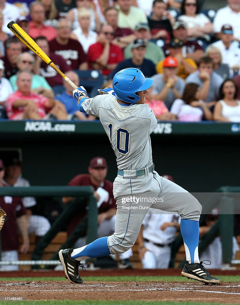 Pat Valaika #10 of the UCLA Bruins hits an RBI single in the first inning against the Mississippi State Bulldogs during game one of the College World Series Finals on June 24, 2013 at TD Ameritrade Park in Omaha, Nebraska. UCLA won 3-1.