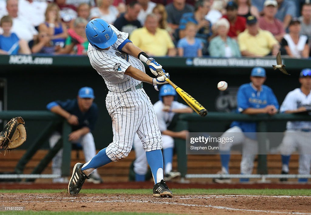 Pat Valaika #10 of the UCLA Bruins hits an RBI single in the third inning against the Mississippi State Bulldogs during game two of the College World Series Finals on June 25, 2013 at TD Ameritrade Park in Omaha, Nebraska.