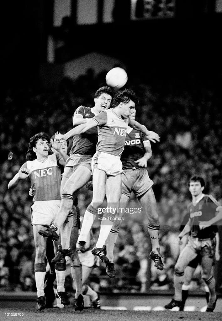 Pat Van Den Hauwe (front, centre) of Everton heads the ball with Tony Gale of West Ham United during the Everton v West Ham United Division 1 match played at Goodison Park, Liverpool on the 5th May 1986. Everton won the match 3-1.