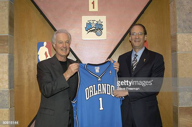 Pat Williams representative of the Orlando Magic stands with NBA Deputy Commissioner Russ Granik as the Orlando Magic won the pick in the 2004 NBA...