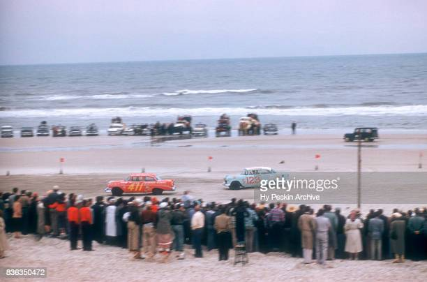 Pat Zocano in the Chevrolet car and Charles Oldham in the Chevrolet car race along the beach during the Daytona Beach and Road Course on February 26...