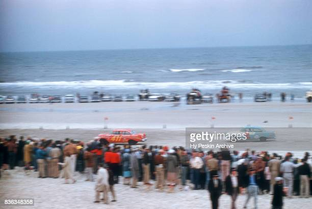 Pat Zocano in the Chevrolet car and Gwyn Staley in the Chevrolet car race along the beach during the Daytona Beach and Road Course on February 26...