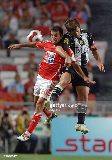 Patacas of Nacional da Madeira and Simao Sabrosa of Benfica in action during the third round of a Portuguese League game between Nacional da Madeira...