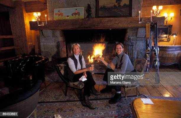 Patagonia Argentina Argentina Two women drinking something next to the fire