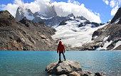 Man, blue lake, glacier and mountains. El Chalten (Argentina's Trekking Capital) - Patagonia