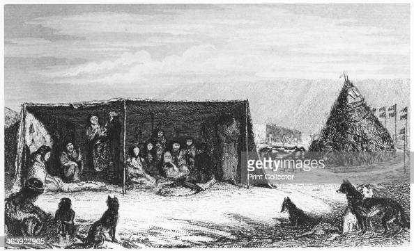 Patagonians in a 'toldo' or skin tent 1830 On the right is the tomb of a child who has recently died and facing it are the stuffed skins of two...