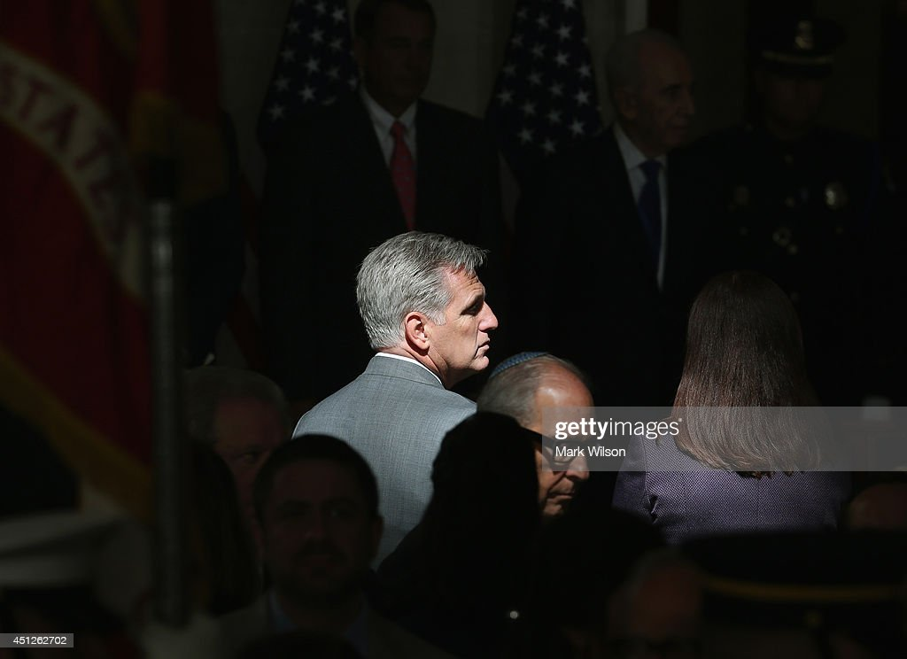 A patch of light hits House Majority Whip Kevin McCarthy (R-CA) during a Congressional Gold Medal ceremony at the U.S. Capitol, June 26, 2014 in Washington, DC. Israeli President Shimon Peres was presented with the Congressional Gold Medal which recognizes those who have performed an achievement that has an impact on American history and culture.
