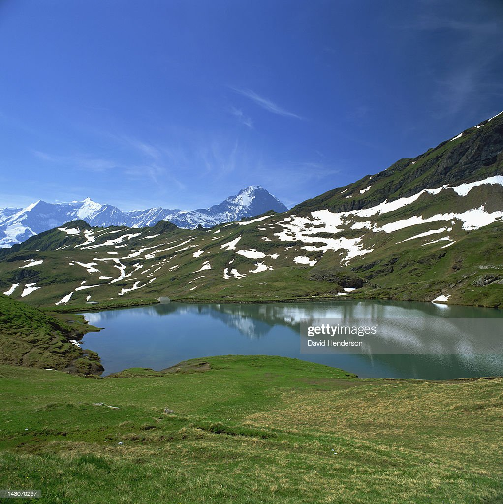 Patches of snow on rural hillside : Stock Photo