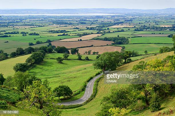 Patchwork fields, winding road, River Severn, Gloucestershire, UK