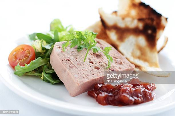 pate with melba toast, chutney and salad on white