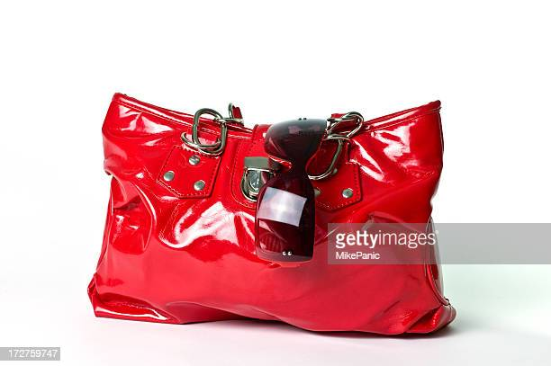 patent leather purse and sunglasses