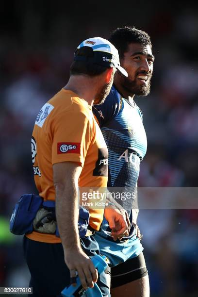 Paterika Vaivai of the Titans leaves the field with a trainer during the round 23 NRL match between the St George Illawarra Dragons and the Gold...