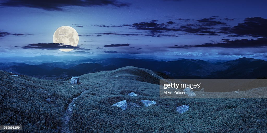 path among stones on mountain top at night : Stockfoto
