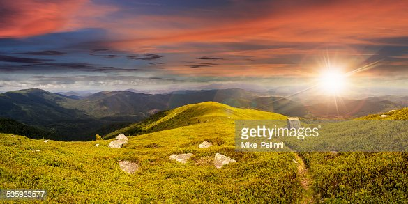 path among stones on mountain top at sunset : Stock Photo