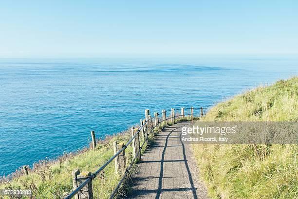 Path by the sea, sea and sky merge