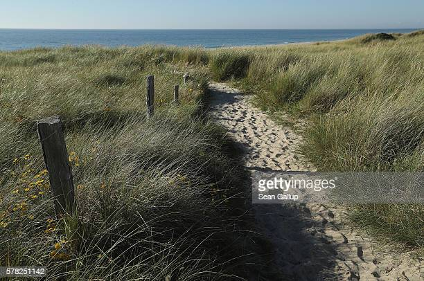 A path leads towards the beach among protected dunes on the northern end of Sylt Island on July 19 2016 near List Germany Sylt Island with its long...