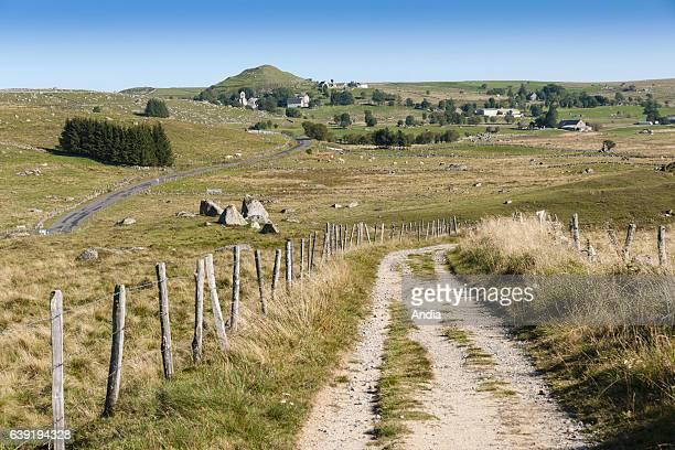 Path on the 'plateau de l'Aubrac' plateau In the background the village of Rieutortet