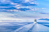 The white liner sailing on blue water