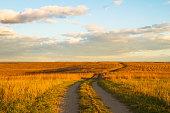 Gravel pathway on Wah'Kon-Tah Prairie towards sunset