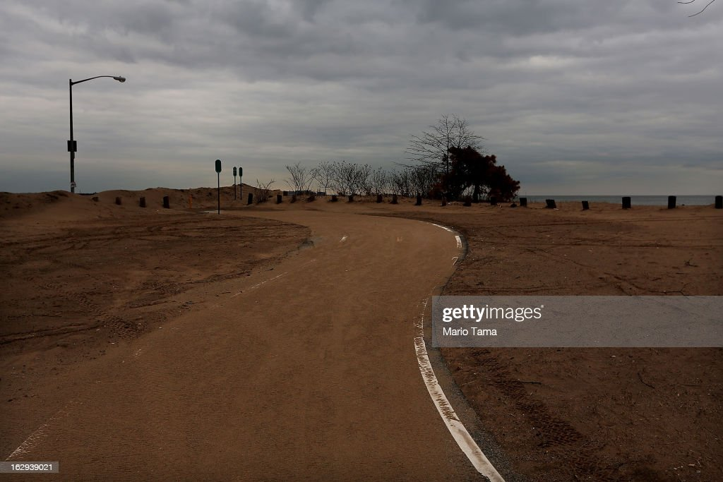 A path remains covered in sand in a beach area damaged by flooding from Hurricane Sandy on March 1, 2013 in the Staten Island borough of New York City. A government plan to purchase properties in Staten Island damaged by the storm remains on track.