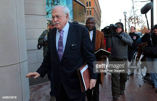 Pathologist Dr Michael Baden waves off media questions as he arrives to testify before the grand jury concerning the Michael Brown shooting at the...