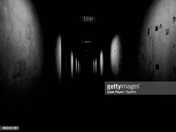 Pathway Amidst Wall In Darkroom