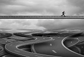Pathway to freedom and concept for escape and a way forward towards success as a businessman finding the solution path and rise above and leave the confusion of a group of tangled roads below with 3D