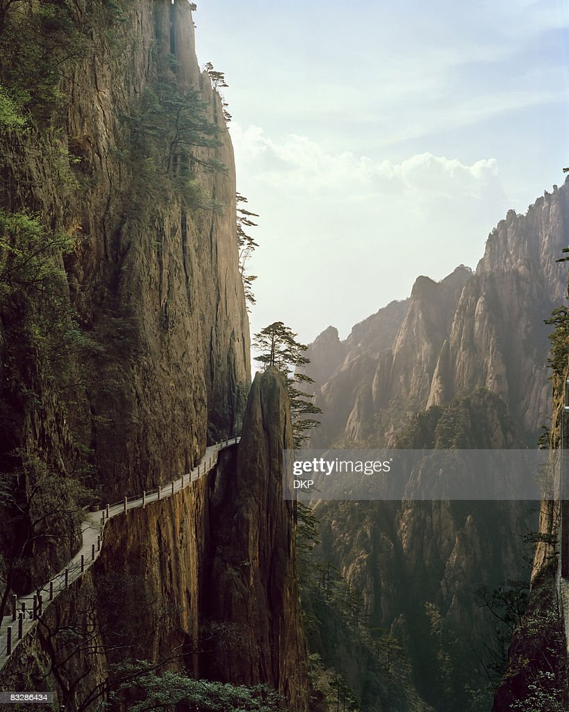 Pathway winding through Chinese mountian landscape : Stock Photo