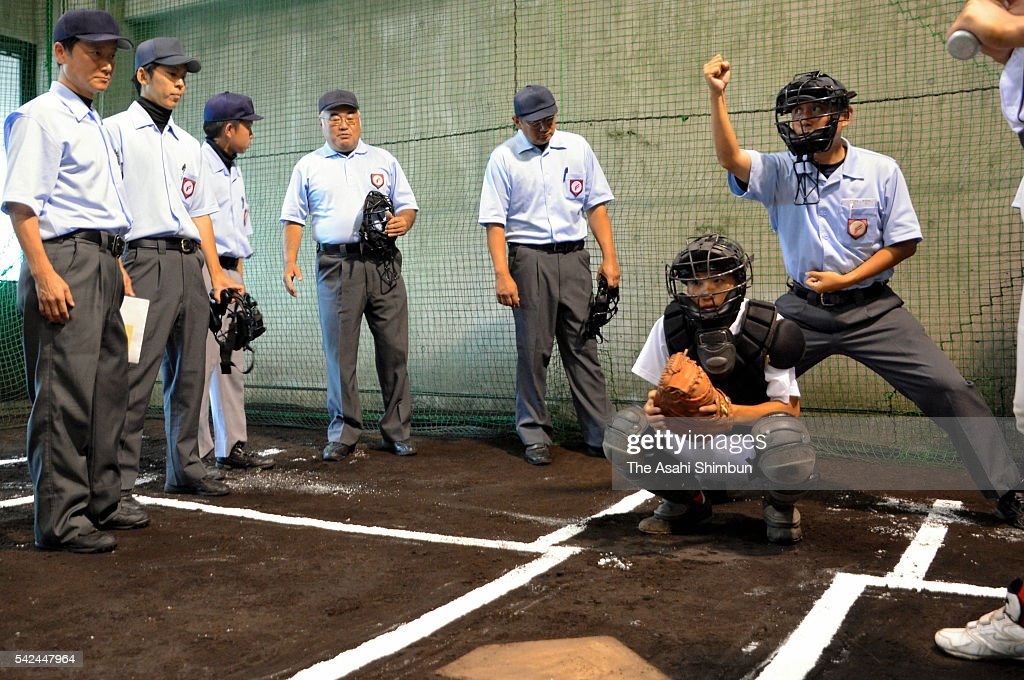 Paticipants attend an umpire training session ahead of the High school baseball championship on June 19 2016 in Yonago Tottori Japan